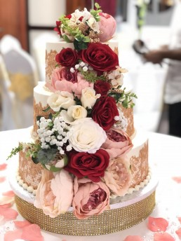 Floral White and Pink Wedding Cake with crystals by JusCakes